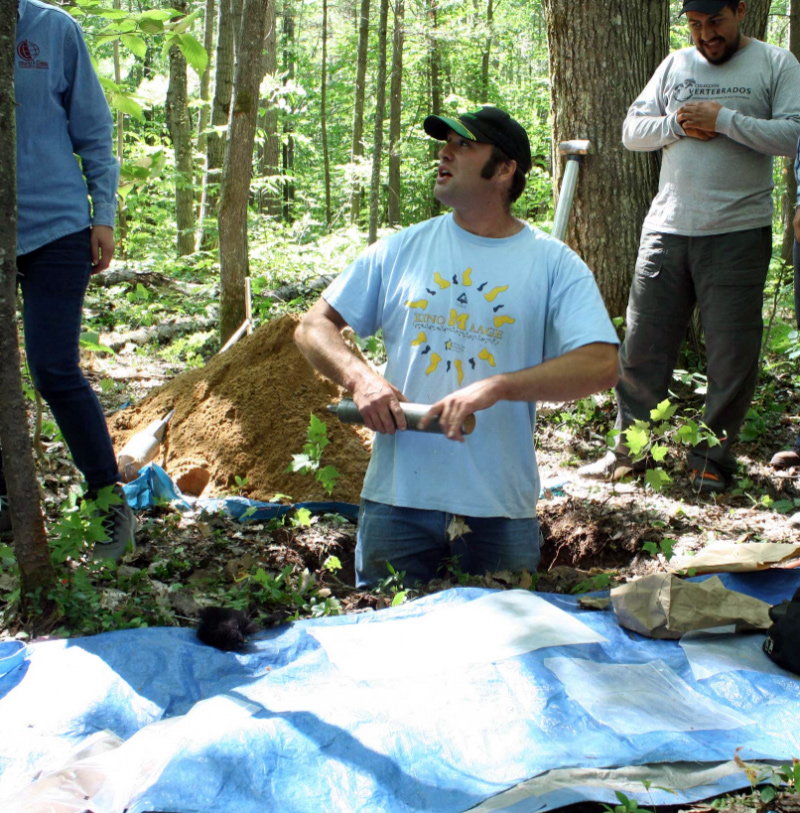 Luke Nave demonstrates methods to measure soil carbon at University of Michigan Biological Station.